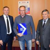 """Sergey Korolyov, Head of the Cement Production, receives the diploma of the Program """"100 Best Products of Russia""""."""