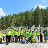 Happy pupils and students after ecogame in Pecherki quarry.