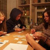 The contestants invent the board game.